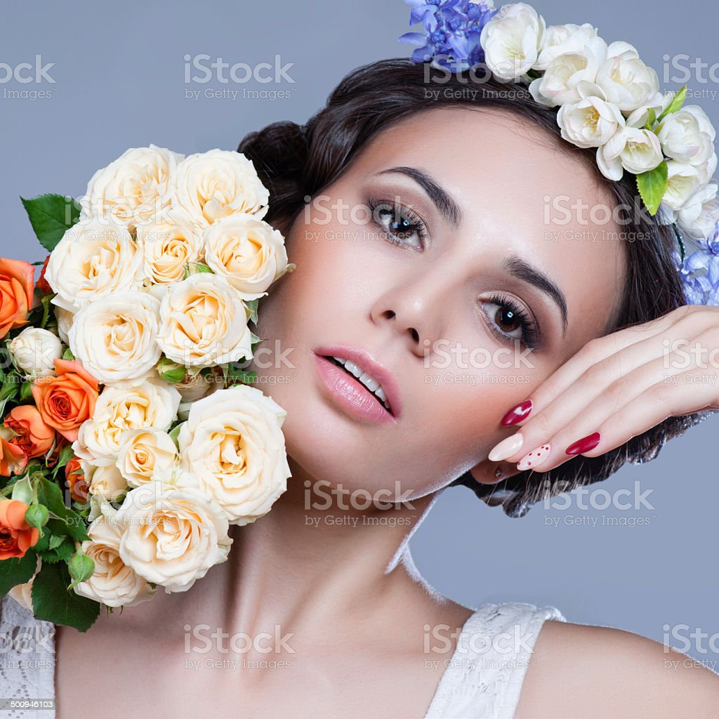 Portrait of a beautiful woman with flowers in her hair stock photo portrait of a beautiful woman with flowers in her hair royalty free stock photo dhlflorist Gallery