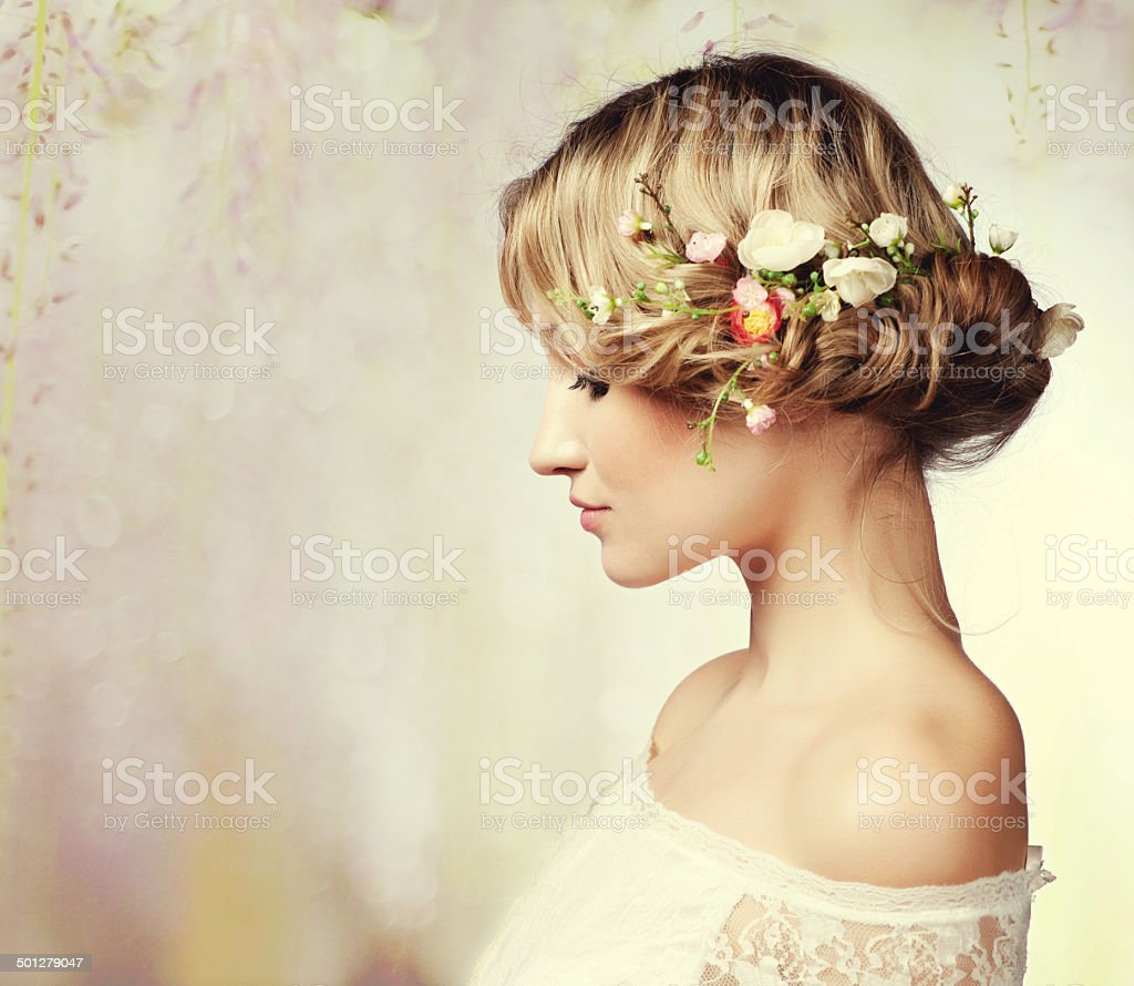 Portrait of a beautiful woman with flowers in her hair stock photo