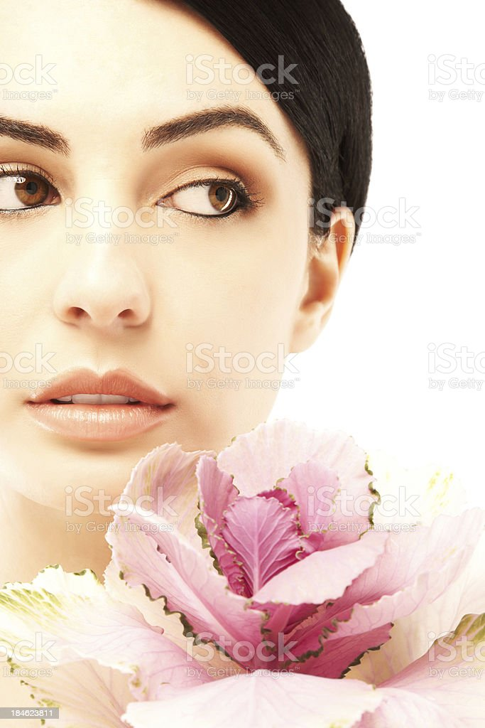 Portrait of a beautiful woman with pink flower royalty-free stock photo