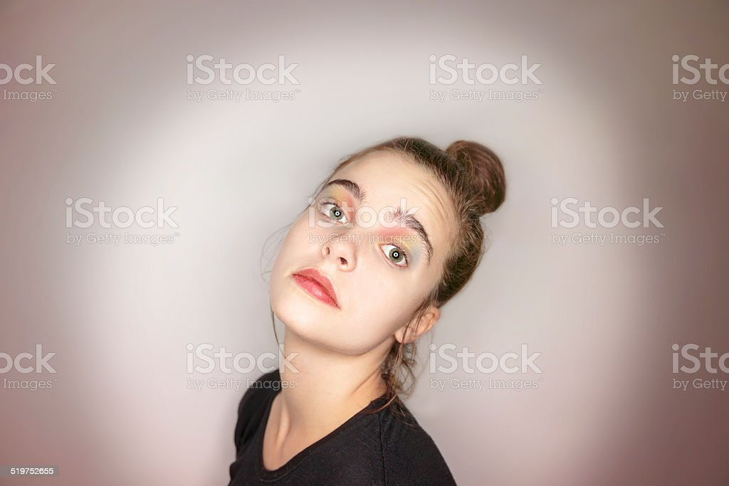 portrait of a beautiful woman with rainbow make-up stock photo