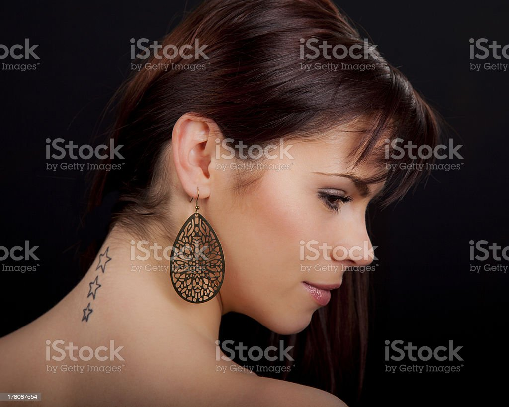 Portrait of a beautiful woman with tattoo on her back royalty-free stock photo