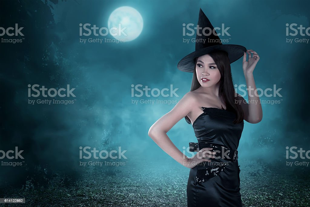 Portrait of a beautiful woman with the hat and witch stock photo