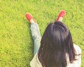 Portrait of a beautiful young asian girl relaxing in park