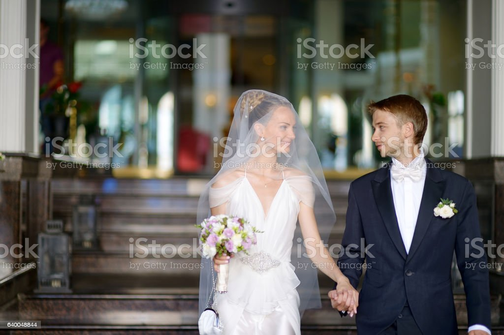 Portrait of a beautiful young bride and groom stock photo