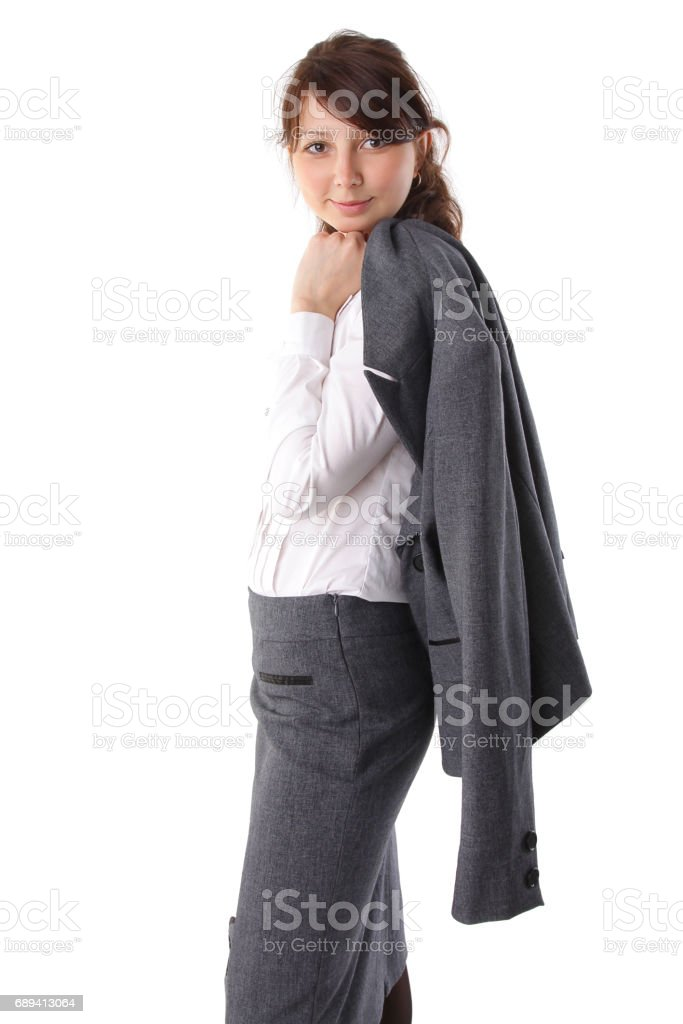 Portrait of a beautiful young business woman in suit, happy and smiling on isolated background stock photo