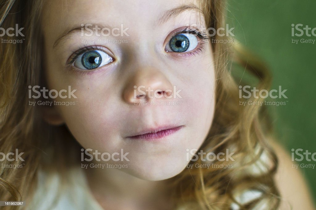 Portrait of a beautiful young girl with huge blue eyes stock photo