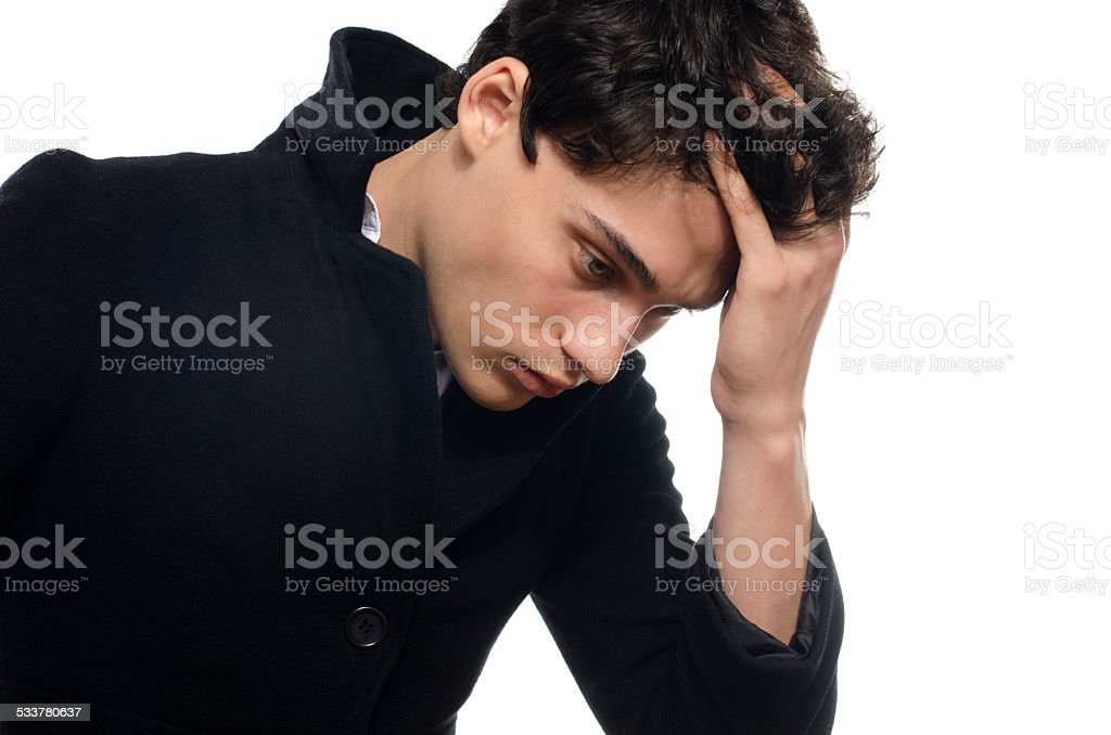 Portrait of a beautiful young man dressed in black coat stock photo