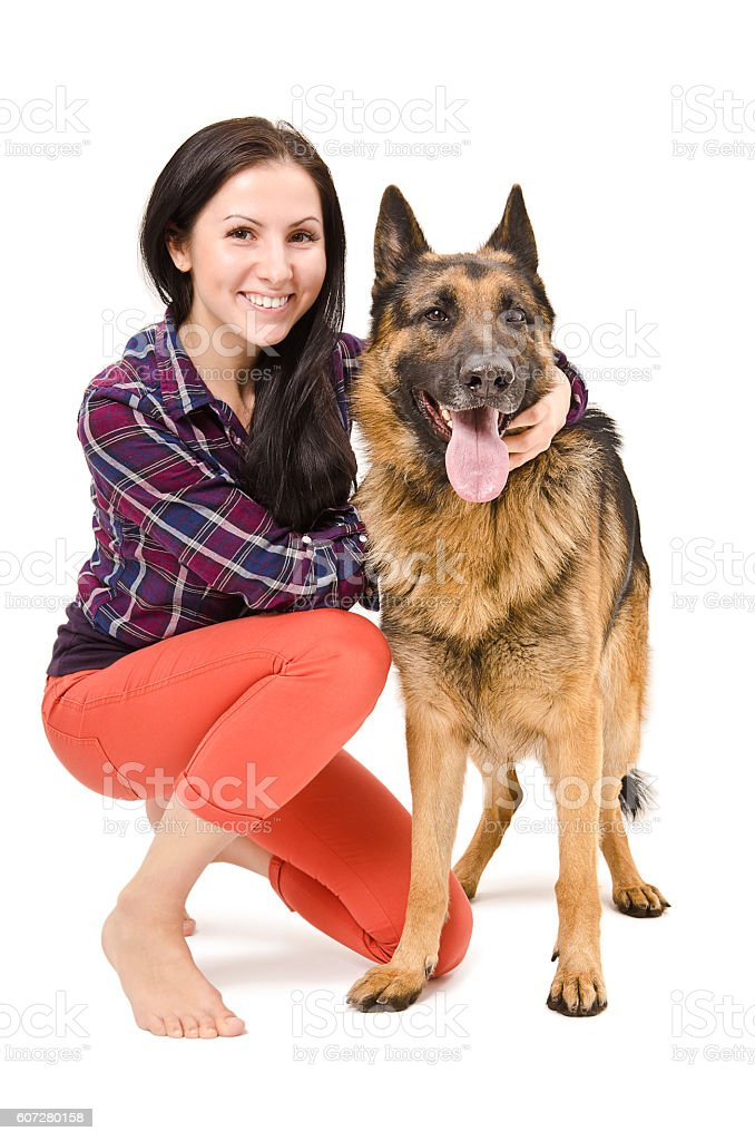 Portrait of a beautiful young woman and German Shepherd stock photo