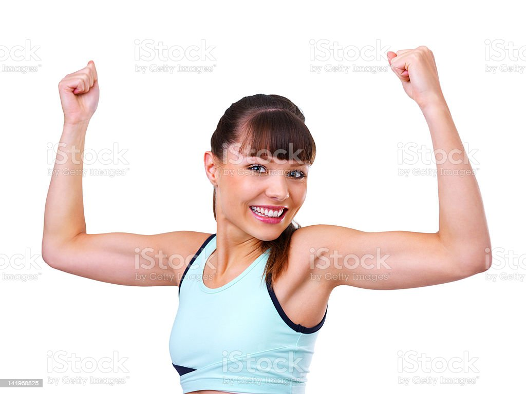 Portrait of a beautiful young woman flexing muscles royalty-free stock photo