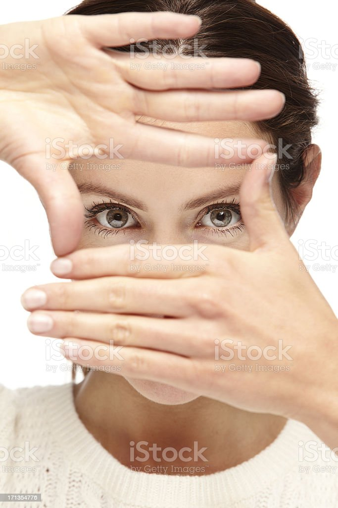 Portrait of a beautiful young woman framing her face royalty-free stock photo