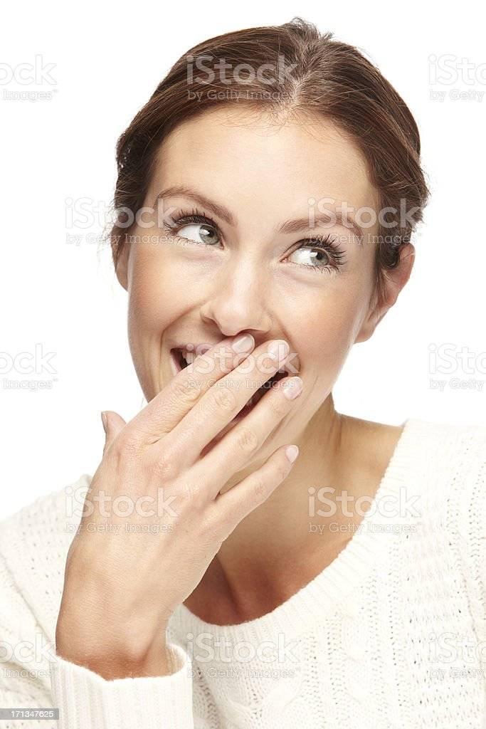 Portrait of a beautiful young woman giggling stock photo