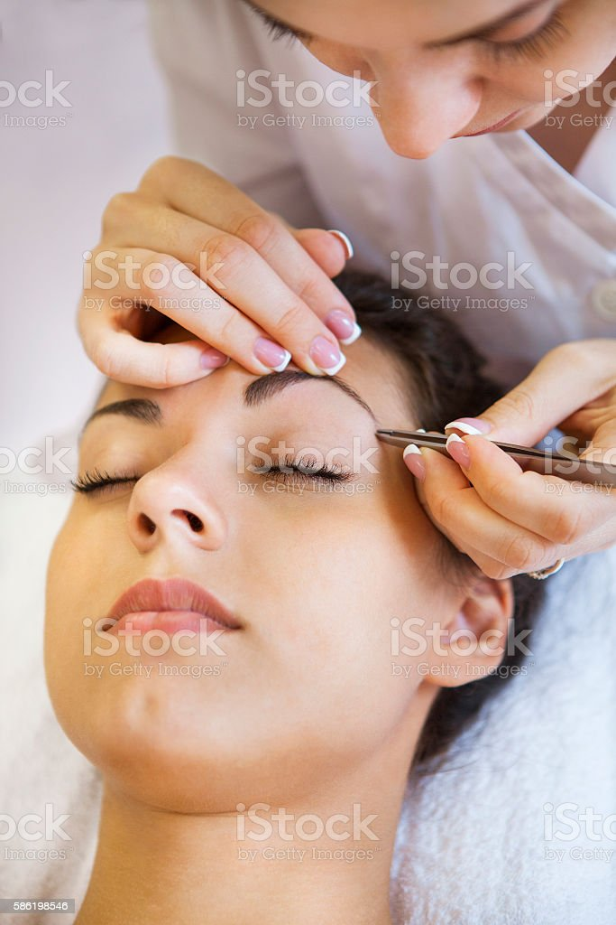 Portrait of a beautiful young woman in cosmetic salon stock photo