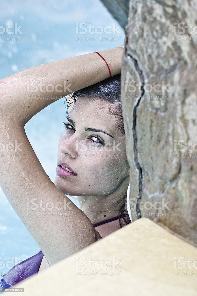 Portrait of a beautiful young woman in swimming pool royalty-free stock photo