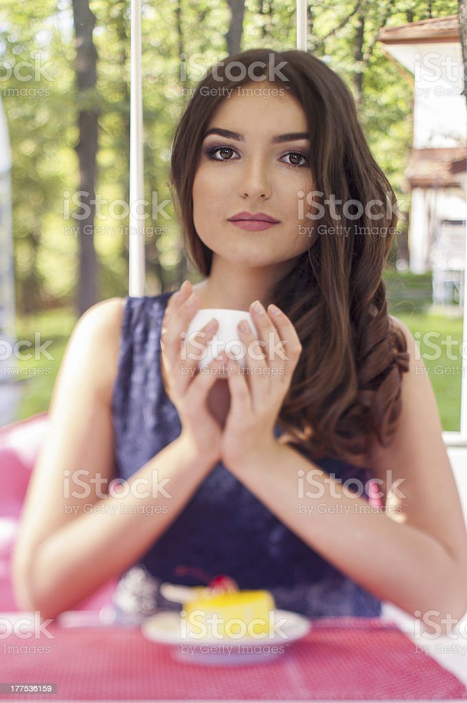 Portrait of a beautiful young woman on nature. royalty-free stock photo