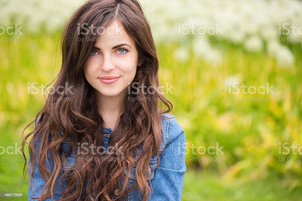 Portrait of a beautiful young woman outdoor stock photo