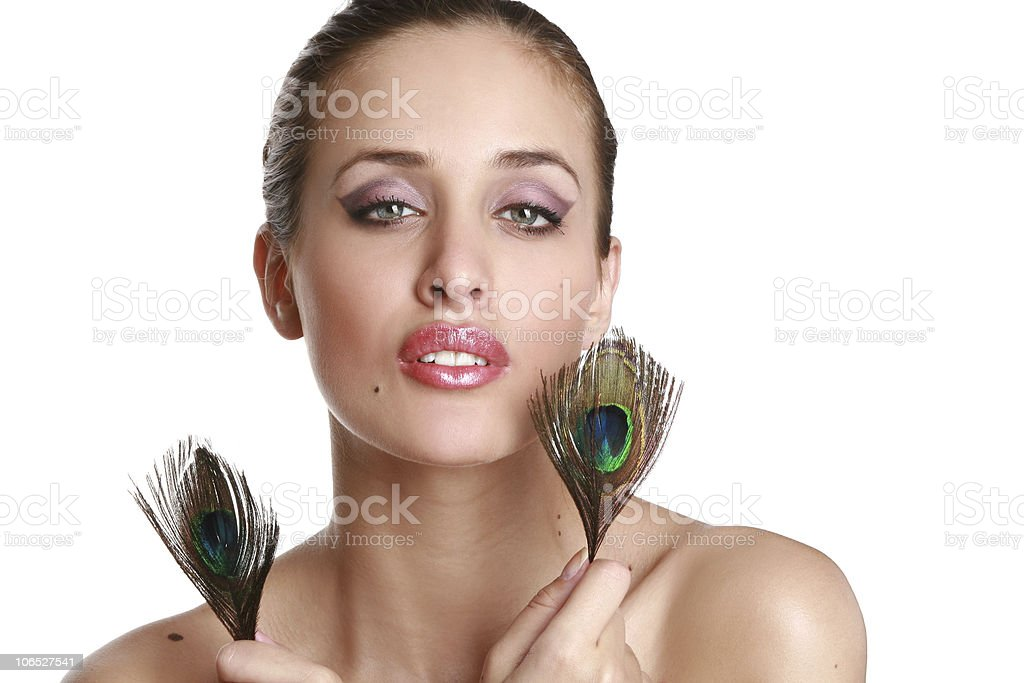 Portrait of a beautiful young woman with peacock feather stock photo