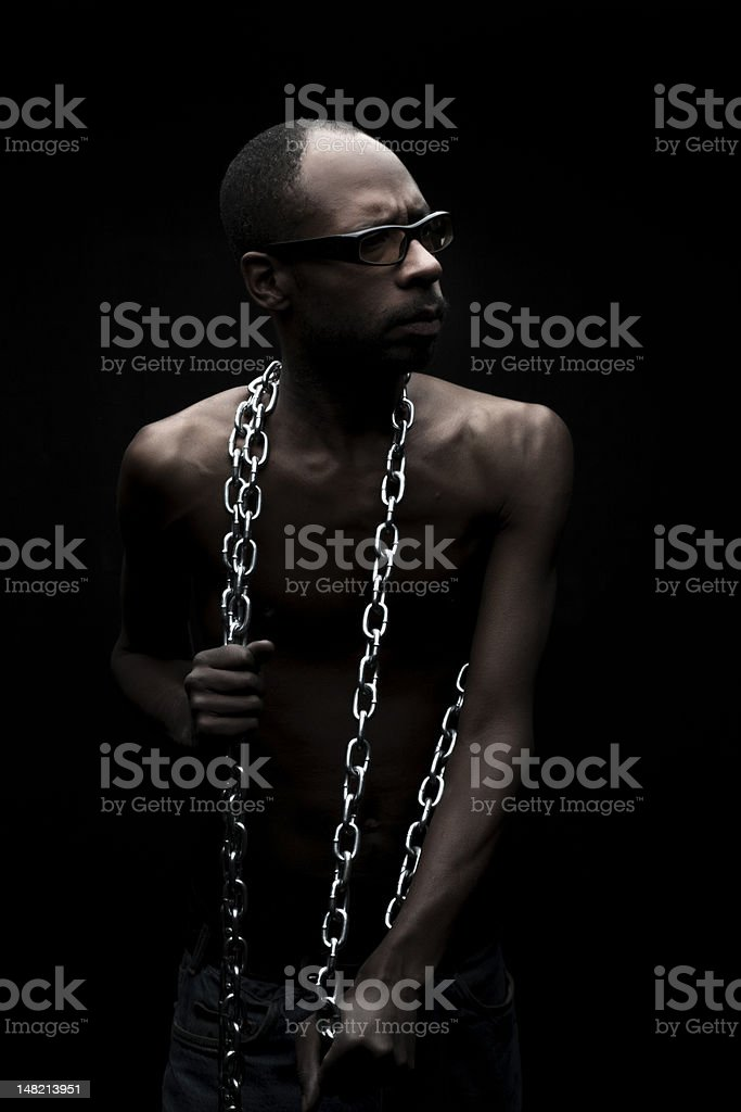 Portrait of a Black Man in Chains stock photo