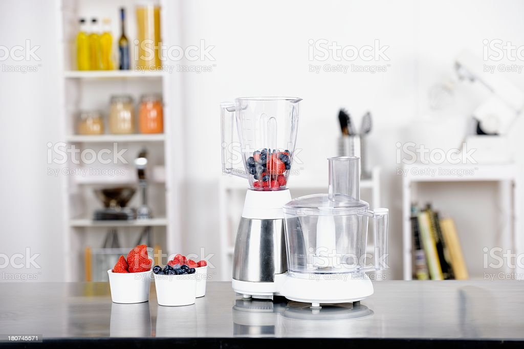 Portrait Of A Blender Containing Fruit royalty-free stock photo