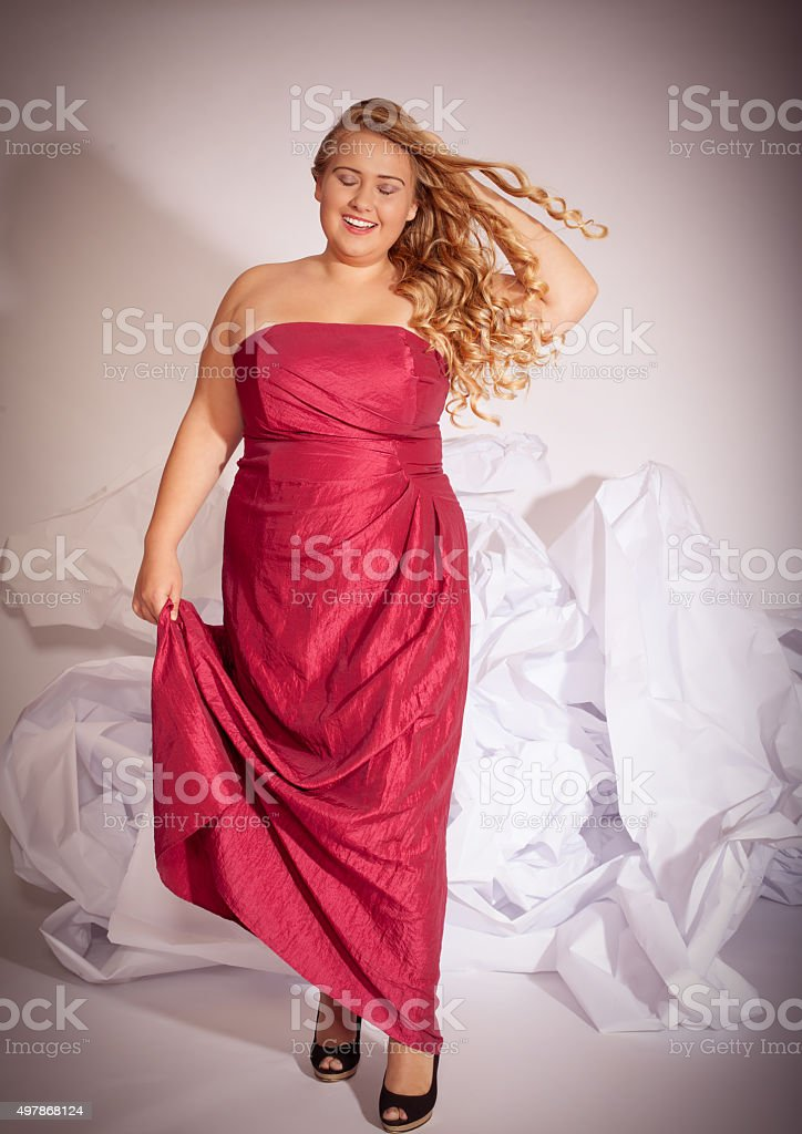 Portrait of a blond curly woman with big boobs stock photo