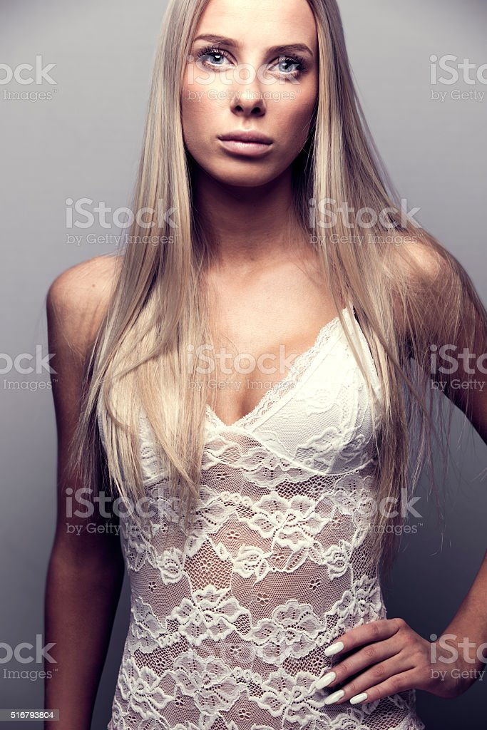 Portrait of a blonde woman model in bodysuit stock photo