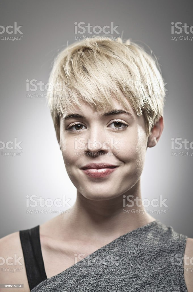 A portrait of a blonde woman smiling at the camera royalty-free stock photo
