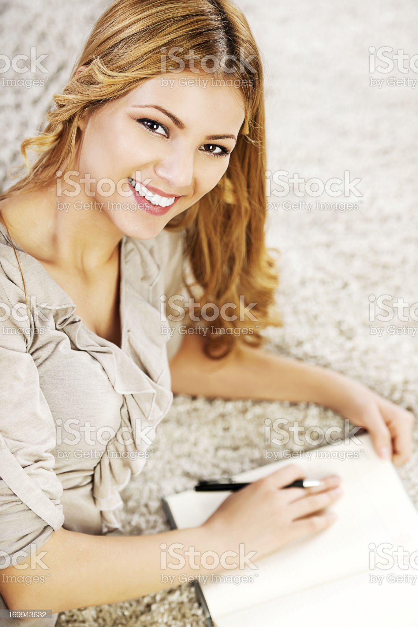 Portrait of a blonde woman writing diary. royalty-free stock photo