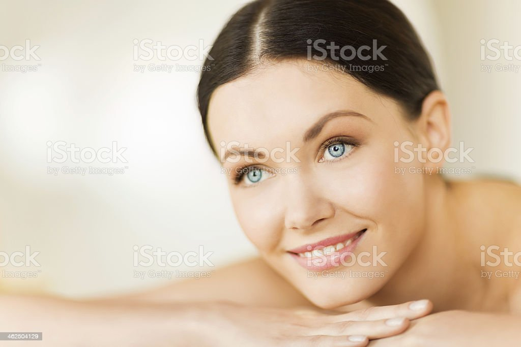Portrait of a blue eyed woman receiving a spa treatment stock photo