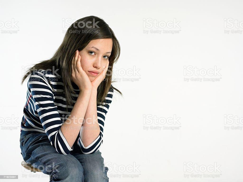 Portrait of a bored teenage girl stock photo