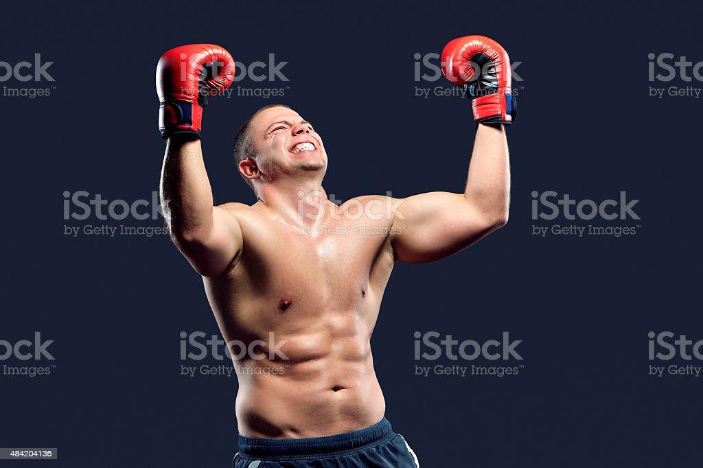 Portrait of a boxer champion enjoying his victory. Studio shot stock photo
