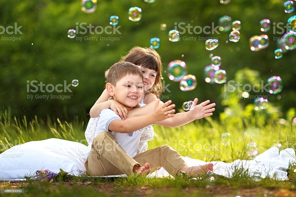 Portrait of a boy and girl in summer stock photo