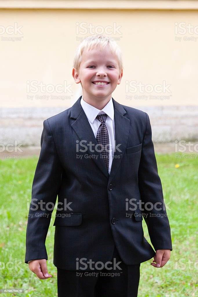 Portrait of a boy in a business suit stock photo