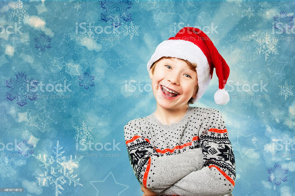 Portrait of a boy in christmas hat with happy and stock photo