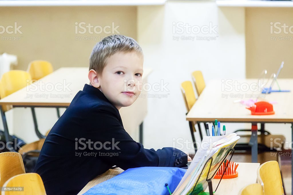 Portrait of a boy in school at his Desk stock photo