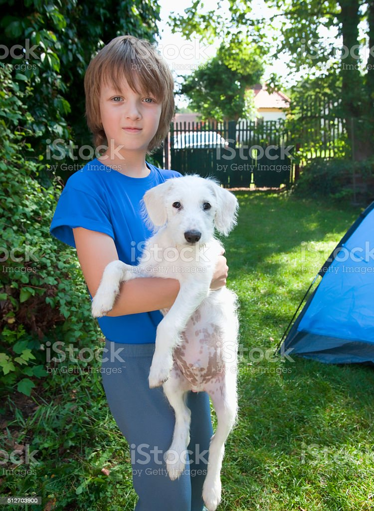 Portrait of a Boy with his Dog stock photo