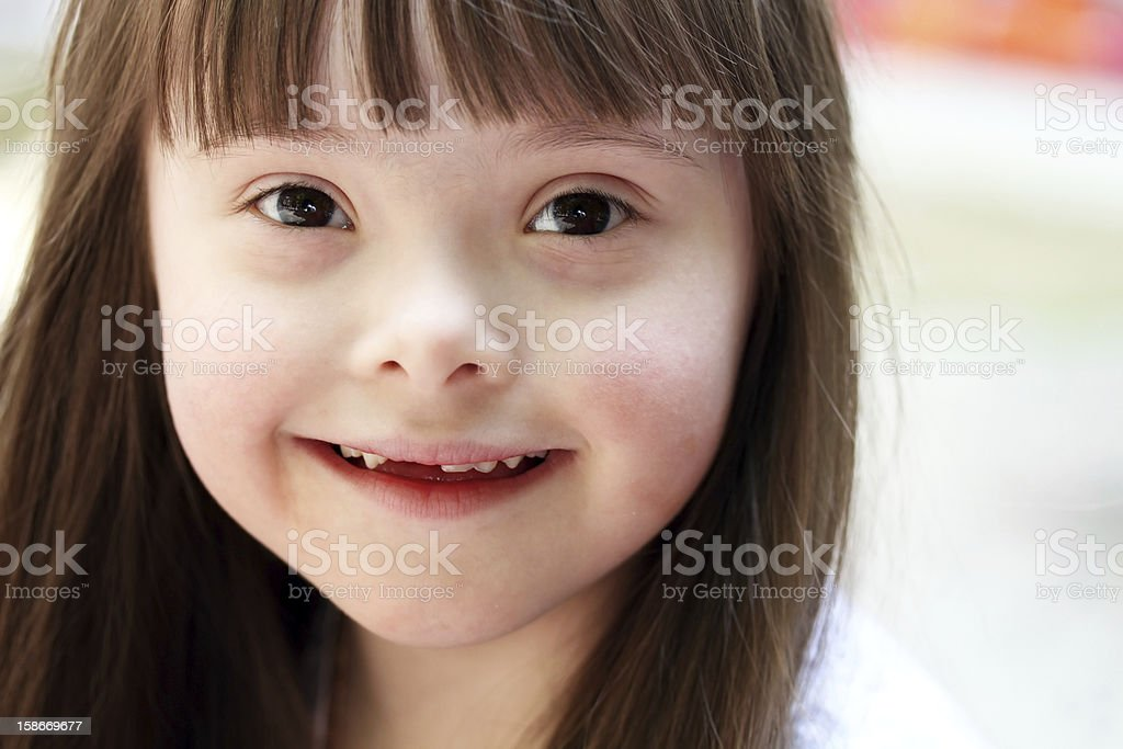 Portrait of a brown haired infant girl stock photo