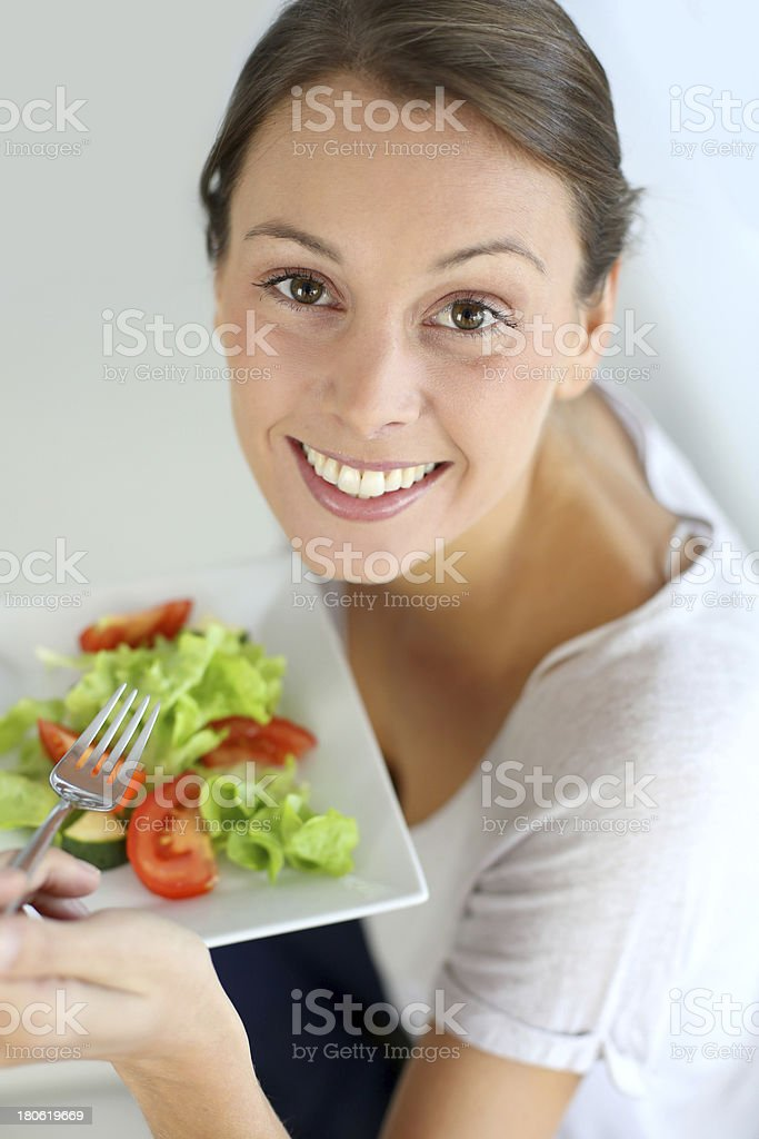 Portrait of a brunette woman eating salad royalty-free stock photo