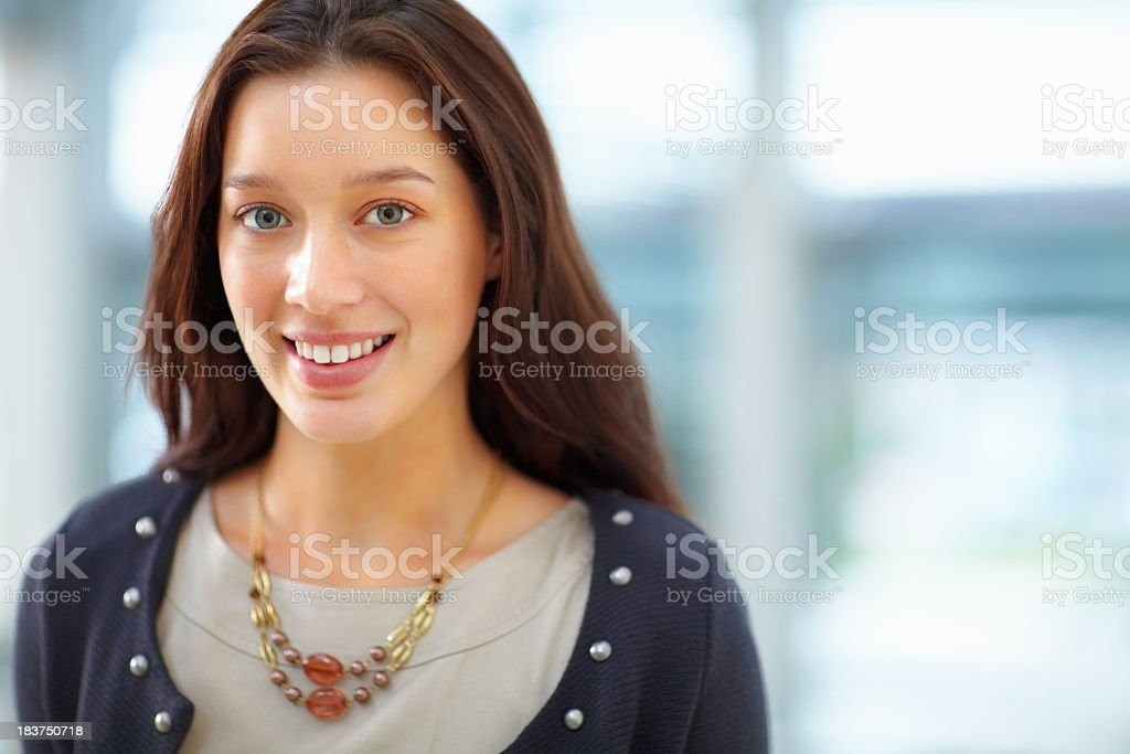 A portrait of a brunette woman with blue eyes royalty-free stock photo