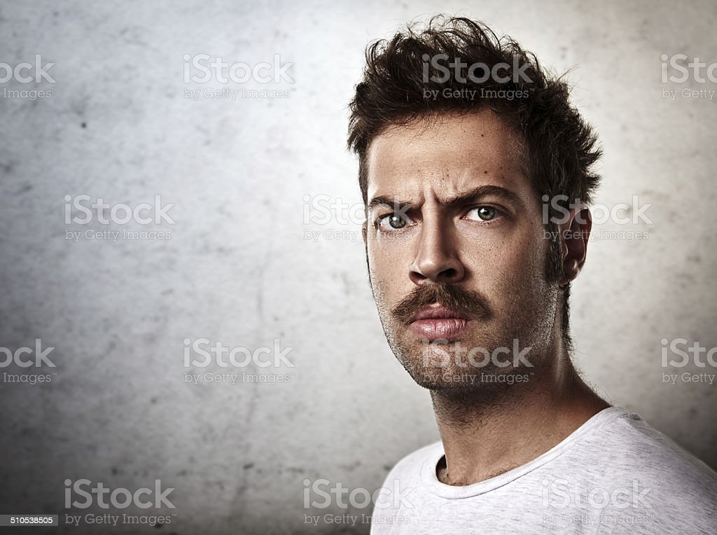 Portrait of a brutal man with a mustache stock photo