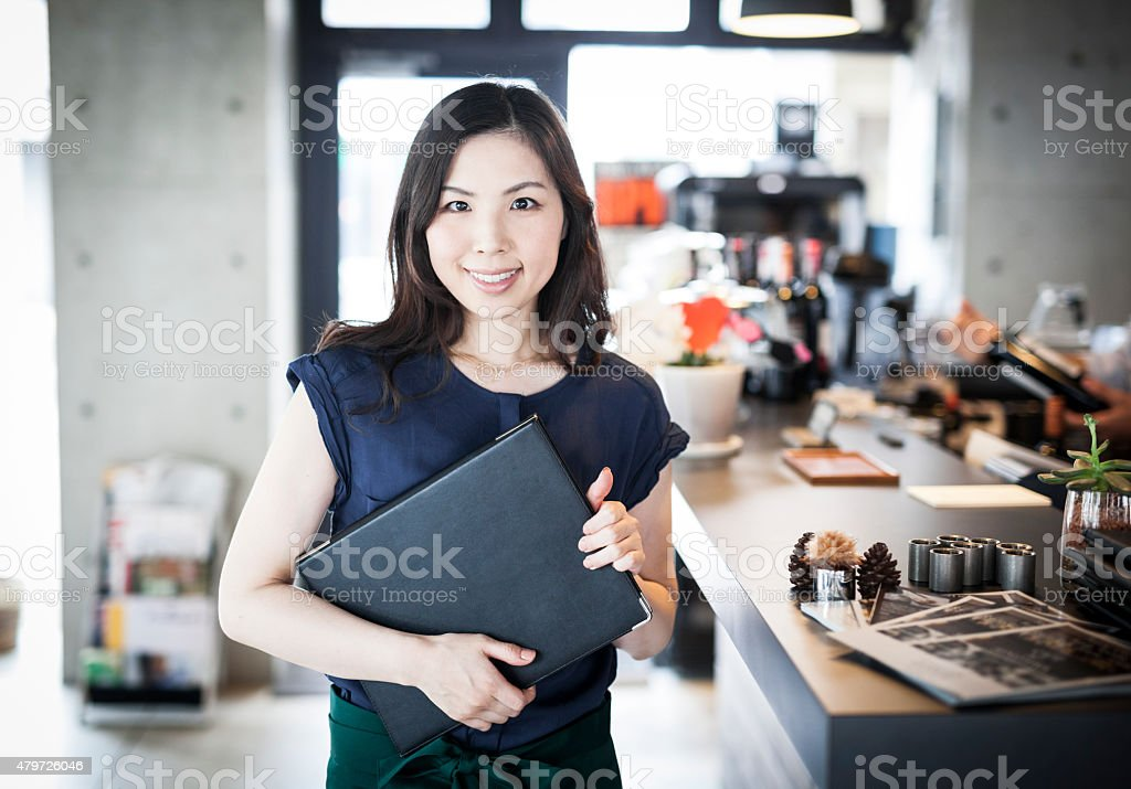 Portrait of a business owner in a restaurant stock photo