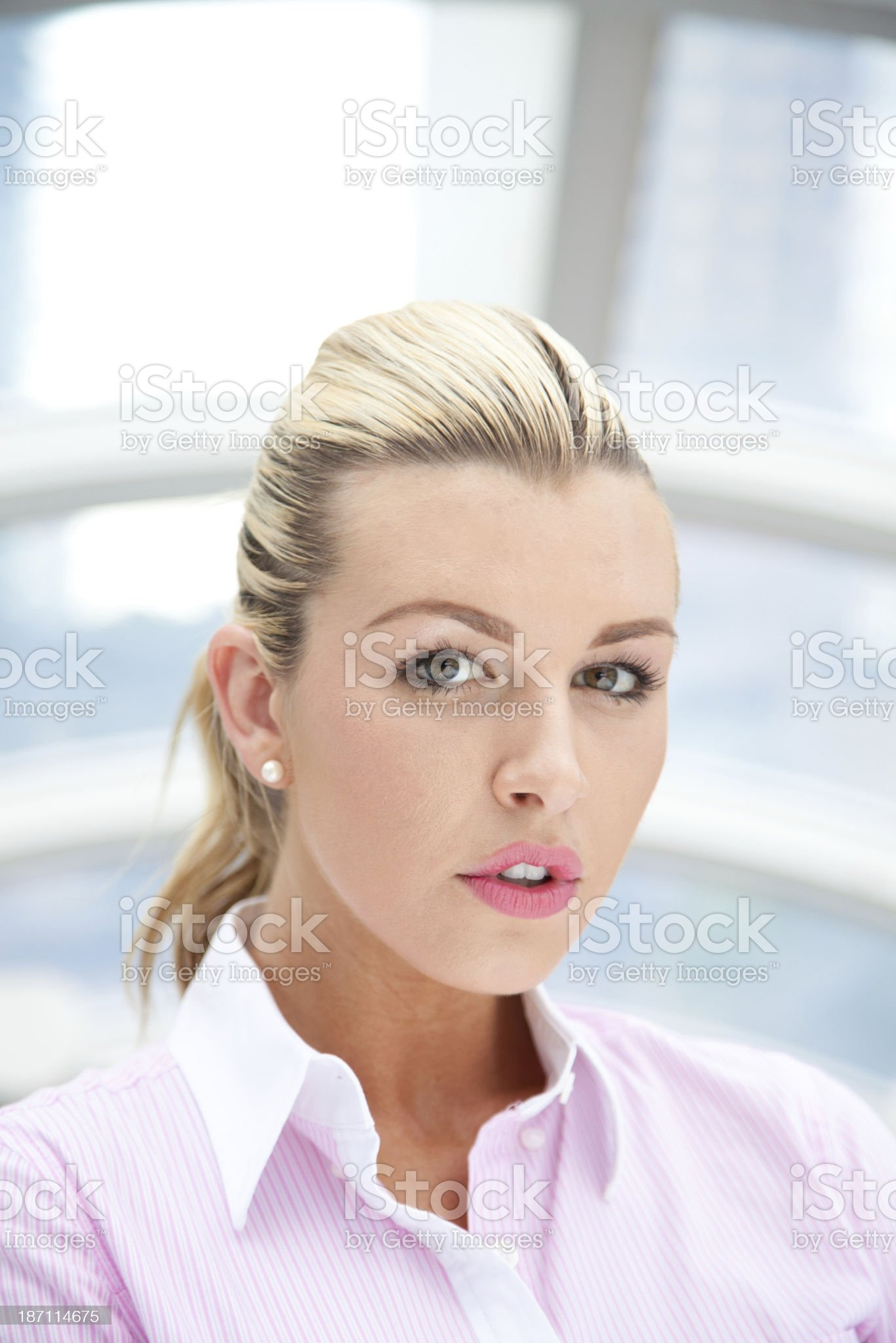 Portrait of a business woman holding her digital tablet royalty-free stock photo