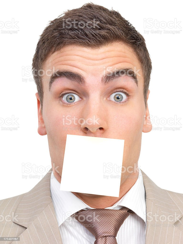 Portrait of a businessman, mouth shut by a note. stock photo