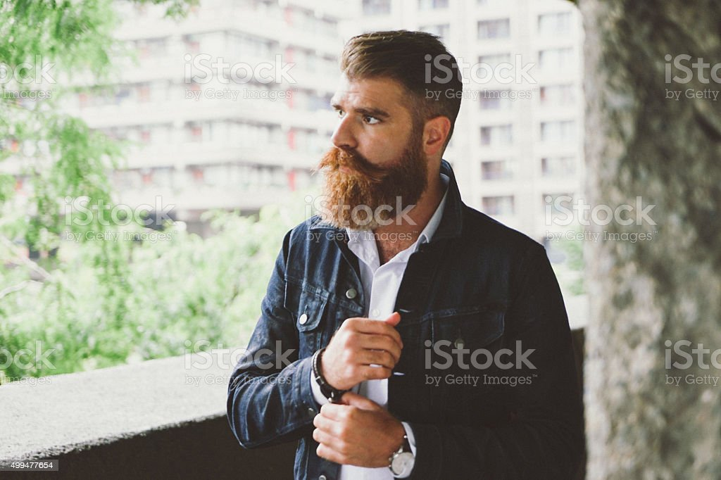 Portrait Of A Businessman Outdoors In Urban Landscape stock photo