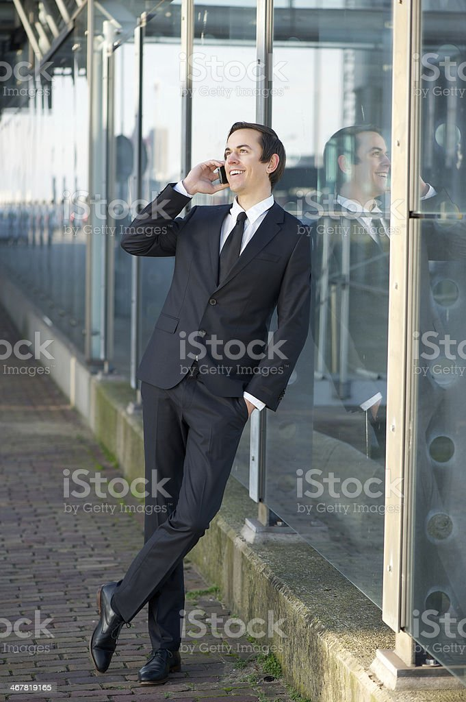 Portrait of a businessman talking on cellphone in the city royalty-free stock photo