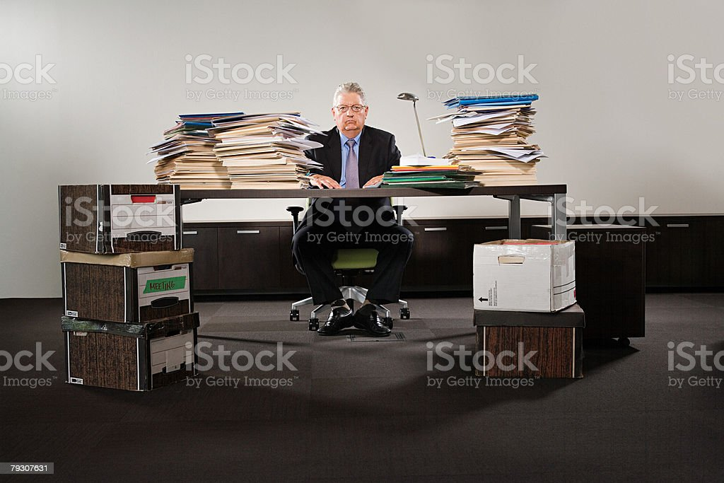 Portrait of a businessman with stacks of files royalty-free stock photo