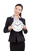 Portrait of a businesswoman holding a clock