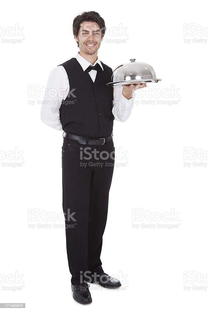 Portrait of a butler with bow tie and tray royalty-free stock photo