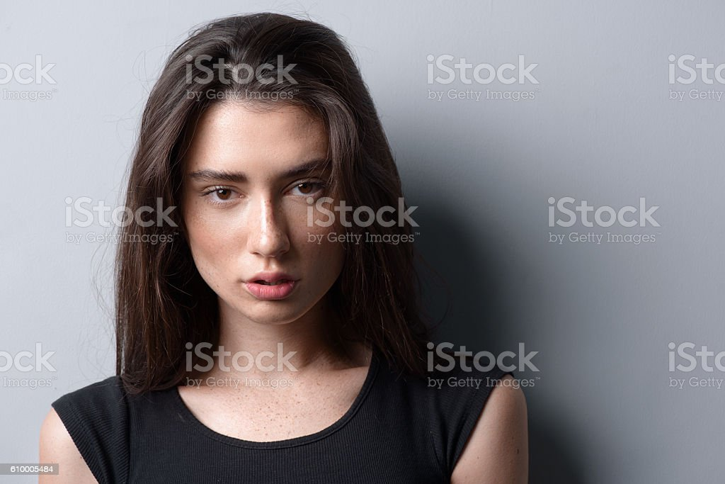 portrait of a calm beautiful woman looking into camera stock photo