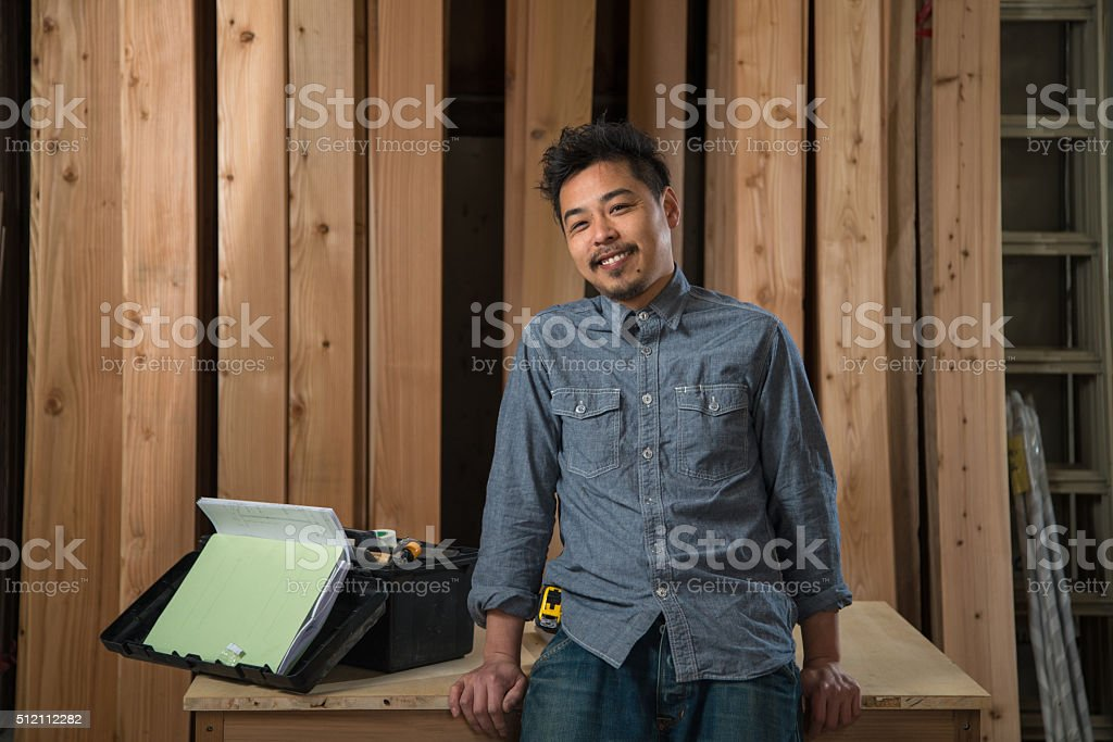 Portrait of a carpenter in a workshop stock photo