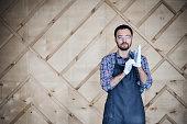 Portrait of a carpenter working in workshop wearing gloves