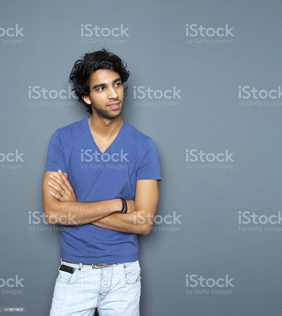 Portrait of a casual man standing with arms crossed stock photo